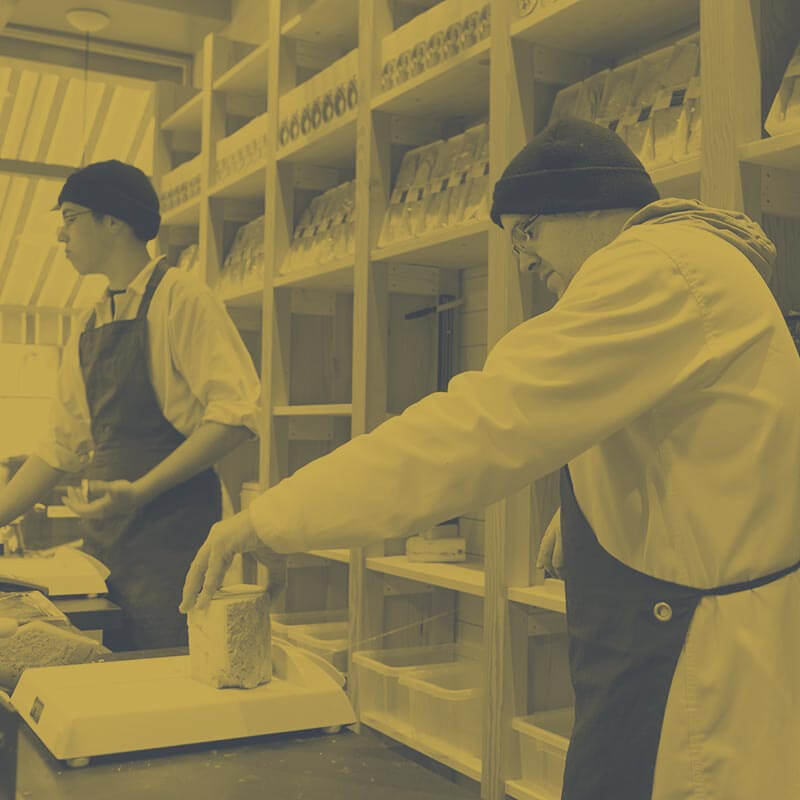 George Mewes: Artisan Cheese & Cheesemonger – cutting cheese